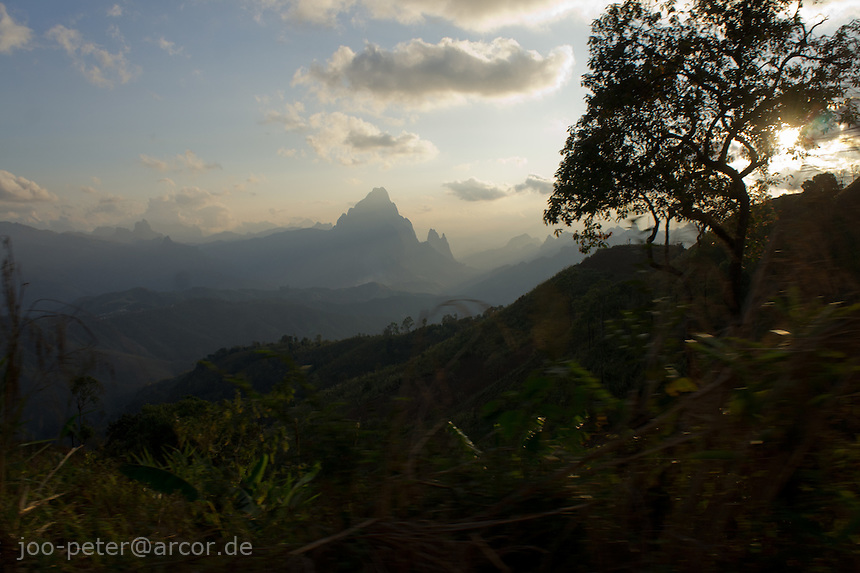 landscape on the way to Vang Vieng at sunset time, , shot while driving,  Laos, 2012