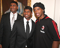 Rinku Singh and Dinesh Patel of the Pittsburg Pirates pose with Ronaldinho of AC Milan at a reception for AC Milan at DAR Constitution Hall in Washington DC on May 24 2010.