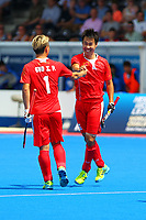 China's Guo Xiaoping congratulates Su Jun on scoring his goal during the Hockey World League Semi-Final Pool A match between China and Korea at the Olympic Park, London, England on 17 June 2017. Photo by Steve McCarthy.