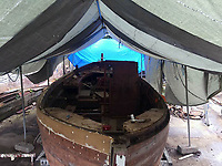 BNPS.co.uk (01202 558833)<br /> Pic: MattCain/BNPS<br /> <br /> Back to the bare bones, restoration work underway. <br /> <br /> A lifeboat which was present at Dunkirk is set to sail there on the 80th anniversary of the mass evacuation after being painstakingly restored.<br /> <br /> The Lady of Mann was lifeboat number eight on board the passenger ship RMS Lady of Mann, which brought 4,262 men back to England in May 1940.<br /> <br /> It was also on the Isle of Man Steam Packet Company vessel when it carried six landing craft, 55 officers and 435 troops to Juno Beach on D-Day in June 1944.<br /> <br /> After the ship was broken up in 1971, the 27ft lifeboat was sold off and converted into a fishing boat which operated out of Maldon, Essex. It had been languishing in a rotting, dilapidated state in an Essex boatyard when IT manager Matt Cain paid £3,000 for it in 2009 after spotting it for sale online.<br /> <br /> The boat sank at its mooring in Windsor, Berks, during the floods of February 2014. Since then, Mr Cain, whose grandfather was evacuated at Dunkirk, has spent over £30,000 returning it to its former glory.