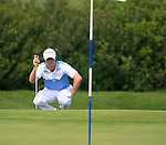 Rory McIlroy (N.IRL) lines up his chip on the 18th green during Day 1 of the Volvo World Match Play Championship in Finca Cortesin, Casares, Spain, 19th May 2011. (Photo Eoin Clarke/Golffile 2011)