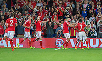 Joe Allen of Wales (far right) is mobbed after scoring his side's second goal during the FIFA World Cup Qualifier match between Wales and Moldova at Cardiff City Stadium, Cardiff, Wales on 5 September 2016. Photo by Mark  Hawkins.
