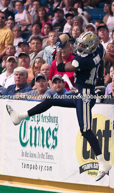 Aug 14, 2010: Tampa Bay Storm wide receiver DeAndrew Rubin (#13) snatches a pass out of the stands. The Storm defeated the Predators 63-62 to win the division title at the St. Petersburg Times Forum in Tampa, Florida. (Mandatory Credit:  Margaret Bowles)