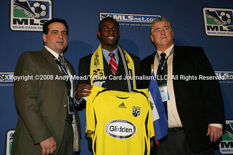 18 January 2008: Ricardo Pierre Louis (HAI), between General Manager Mark McCullers (l) and head coach Sigi Schmid (r), was taken by the Columbus Crew with the 22nd overall pick. The 2008 Major League Soccer SuperDraft was held at the National Soccer Coaches Association of America's annual convention was held at the Convention Center in Baltimore, Maryland.