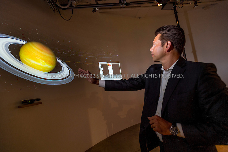8/30/2012--Redmond, WA, USA..Harald Becker, senior Business Strategist for the Office Envisioning at Microsoft Corporation gives a tour of the company's Envisioning Lab. Here Mr. Becker uses Kinect technologies to interact with the WorldWide Telescope. The WorldWide Telescope enables seamless panning and zooming across space, mixing terabytes of images and data from multiple sources over the Internet. The Telescope is a collaborative effort between Microsoft Research as well as academic and government agencies. ..The Envisioning Lab is based in the Executive Briefing Center of Microsoft's global headquarters at Redmond, Washington State, just east of Seattle. Its main purpose is to demonstrate Microsoft's next generation technologies to its key strategic customers. In addition, the Lab provides a stimulating environment for its software and hardware developers to experiment with different ideas and explore new possibilities...©2012 Stuart Isett. All rights reserved.
