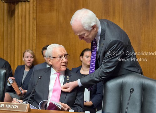 United States Senator John Cornyn (Republican of Texas), right, admires the tie of US Senator Orrin Hatch (Republican of Utah) prior to hearing Christopher A. Wray testify on his nomination to be Director of the Federal Bureau of Investigation (FBI) before the US Senate Committee on the Judiciary on Capitol Hill in Washington, DC on Wednesday, July 12, 2017.  Senator Hatch is the President pro-tempore of the US Senate, making him third in line to the US Presidency after the Vice President and Speaker of the US House of Representatives.<br /> Credit: Ron Sachs / CNP<br /> (RESTRICTION: NO New York or New Jersey Newspapers or newspapers within a 75 mile radius of New York City)