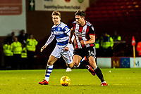 Sheffield United's midfielder Ryan Leonard (14) burst through the midfield past Queens Park Rangers midfielder Luke Freeman (7) during the Sky Bet Championship match between Sheff United and Queens Park Rangers at Bramall Lane, Sheffield, England on 20 February 2018. Photo by Stephen Buckley / PRiME Media Images.