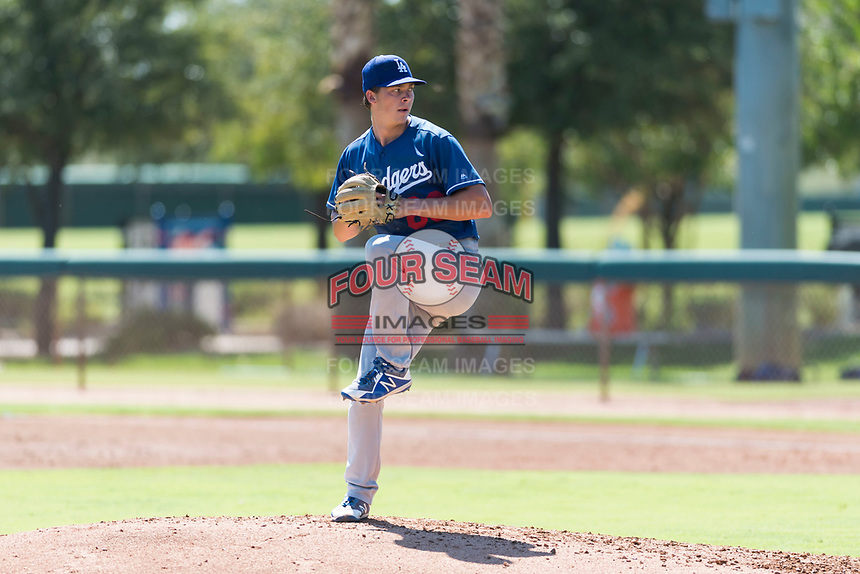 Los Angeles Dodgers relief pitcher Caleb Sampen (83) delivers a pitch during an Instructional League game against the Oakland Athletics at Camelback Ranch on September 27, 2018 in Glendale, Arizona. (Zachary Lucy/Four Seam Images)