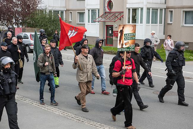 Ca. 1000 Nazis aus ganz Deutschland marschierten am Sonntag den 1. Mai 2016 im Saeschsichen Plauen auf. Die Naziorganisation 3.Weg hatte den Marsch angemeldet. Etliche Nazis waren dabei vermummt und zeigten auch den Hitlergruss, die Polizei schritt jedoch nicht ein.<br /> Nach der Haelfte der Marschroute beendeten die Nazis ihre Demonstration, da die Polizei die Marschroute verkuerzen wollte. Sie forderten die Polizei auf den Weg freizugeben. Danach griffen Aufmarschteilnehmer die Polizei an, die daraufhin Wasserwerfer, Pfefferspray, Traenengas und Schlagstoecke einsetzte. Mehrere Gruppen Nazis zogen danach durch Plauen und jagten Menschen.<br /> Nach einer Stunde bekamen die Nazis einen erneuten Aufmarsch von der Polizei genehmigt und zogen zurueck zum Bahnhof.<br /> Im Bild mit Hamburg-Fahne: Thomas &quot;Steiner&quot; Wulff, Nazianfuehrer aus Hamburg. Seinen Spitznamen hat er sich vom SS Obergruppenfuehrer Felix Steiner genommen.<br /> Links mit heller Umhaengetasche: Klaus Armstroff, Gruender und Vorsitzender der Partei &quot;3. Weg&quot;.<br /> 1.5.2016, Plauen<br /> Copyright: Christian-Ditsch.de<br /> [Inhaltsveraendernde Manipulation des Fotos nur nach ausdruecklicher Genehmigung des Fotografen. Vereinbarungen ueber Abtretung von Persoenlichkeitsrechten/Model Release der abgebildeten Person/Personen liegen nicht vor. NO MODEL RELEASE! Nur fuer Redaktionelle Zwecke. Don't publish without copyright Christian-Ditsch.de, Veroeffentlichung nur mit Fotografennennung, sowie gegen Honorar, MwSt. und Beleg. Konto: I N G - D i B a, IBAN DE58500105175400192269, BIC INGDDEFFXXX, Kontakt: post@christian-ditsch.de<br /> Bei der Bearbeitung der Dateiinformationen darf die Urheberkennzeichnung in den EXIF- und  IPTC-Daten nicht entfernt werden, diese sind in digitalen Medien nach &sect;95c UrhG rechtlich geschuetzt. Der Urhebervermerk wird gemaess &sect;13 UrhG verlangt.]