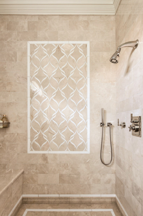This custom Sophie mosaic shower is shown in Botticino and Thassos and is part of the Silk Road Collection by Sara Baldwin for New Ravenna.<br />
