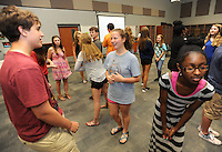 NWA Democrat-Gazette/ANDY SHUPE<br /> Annaleise Gates, 14, (center) speaks Wednesday, Sept. 2, 2015, with Jason Dalton, 15, (left) alongside Damara Hale, 14, all ninth-graders at Fayetteville High School, while taking part in an exercise in speaking to another person during their advisory period at Fayetteville High School. The students are in the ninth-grade White B small learning community team and spend the period learning about education opportunities and building related skills.