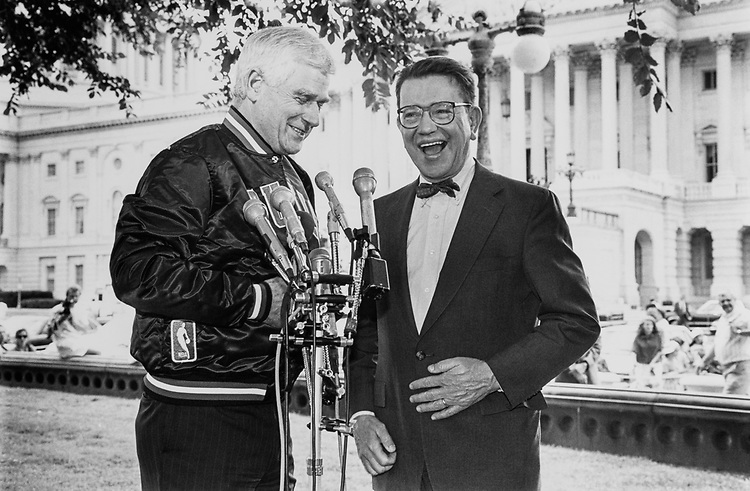 Sen. Mark Hatfield, R-Ore. fulfills his bet with Sen. Paul Simmon, D-Ill. Sen. Mark Hatfield had to commend the Bulls and wears a Bulls jacket on June 29, 1992. (Photo by Chris Ayers/CQ Roll Call)