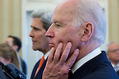 """United States Vice President Joe Biden and U.S. Secretary of State John F. Kerry, left, listen to remarks as U.S. President Barack Obama and Prime Minister Benjamin Netanyahu of Israel meet in the Oval Office of the White House in Washington, D.C., U.S., on Monday, March 3, 2014. Obama urged Netanyahu to """"seize the moment"""" to make peace, saying time is running out to negotiate an Israeli-Palestinian agreement. <br /> Credit: Andrew Harrer / Pool via CNP"""