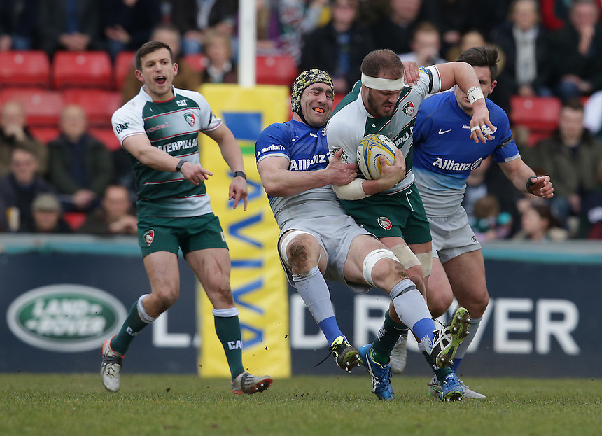 Leicester Tigers' Lachlan McCaffrey is tackled by Saracens' Kelly Brown<br /> <br /> Photographer Stephen White/CameraSport<br /> <br /> Rugby Union - Aviva Premiership Round 17 - Leicester Tigers v Saracens - Sunday 20th March 2016 - Welford Road - Leicester <br /> <br /> &copy; CameraSport - 43 Linden Ave. Countesthorpe. Leicester. England. LE8 5PG - Tel: +44 (0) 116 277 4147 - admin@camerasport.com - www.camerasport.com