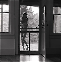 Nude figure in doorway