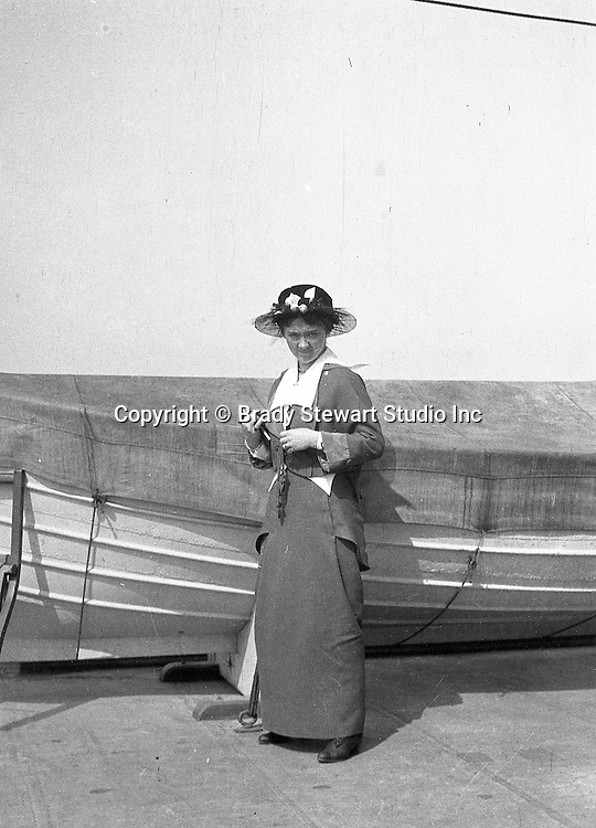 Niagara Falls, New York:  Sarah Stewart standing next to a lifeboat on the Dalhousie City ferry - 1914