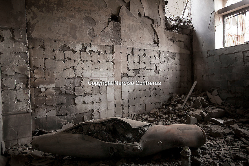 "Wednesday 15 July, 2015: An unexploded bomb lays inside a governmental building targeted by an airstrike in the downtown of Sa'dah, a city subdued to heavy bombardments carried out by tthe Arab states and their western allies led by Saudi Arabia in the northern province of Sa'dah, the stronghold of the Houthi's movement declared unilaterally ""a military zone"". The historic city of Sa'dah is among the places submitted on a tentative list to be under protection of UNESCO as a World Heritage site like the others enlisted cultural heritage sites in Yemen, such as the historic town of Zabid, the Old City of Sana'a and the Old Walled City of Shibam endangered by the ongoing aerial campaign of bombardments. (Photo/Narciso Contreras)"
