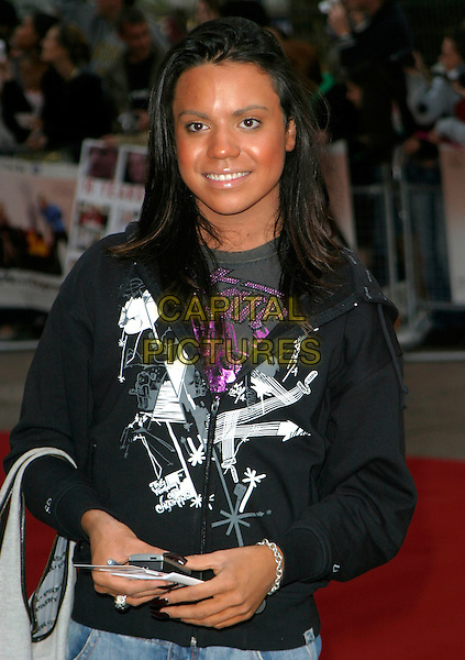 "SAM BRODIE.At the UK Film Premiere of ""You, Me & Dupree"",.Odeon Leicester Square, London, England, .August 22nd 2006..half length tanned black zip-up top white pattern print big brother 7.Ref: AH.www.capitalpictures.com.sales@capitalpictures.com.©Adam Houghton/Capital Pictures."