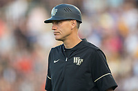 Wake Forest Demon Deacons head coach Tom Walter (16) coaches third base during the game against the West Virginia Mountaineers in Game Four of the Winston-Salem Regional in the 2017 College World Series at David F. Couch Ballpark on June 3, 2017 in Winston-Salem, North Carolina.  The Demon Deacons walked-off the Mountaineers 4-3.  (Brian Westerholt/Four Seam Images)