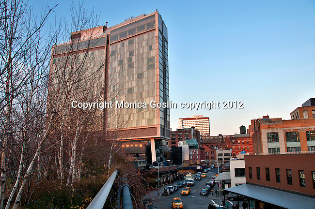 The Standard Hotel in New York City with the Highline, an elevated public park on and old railway line, passing under it and a view of the meatpacking district below