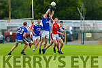 Darragh Rahillly Rathmore  and Peter Crowley Laune Rangers compete for the dropping ball  during their IFC clash in Killarney Friday evening