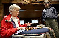 NWA Democrat-Gazette/DAVID GOTTSCHALK Peggy Bowen (left) visits with Bart Taylor, park interpreter, Wednesday, February 6, 2019, as she works on Bobbin Lace during a Spin-A-Round meeting of the Wool and Wheel Handspinners in the Latta Barn at Prairie Grove Battlefield State Park. The group meets every first Wednesday of the month at the park and every third Saturday at Ozark Folkways in Winslow. The group is open to the public and invites participation and observation.