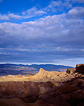 Death Valley National Park, CA<br /> Morning clouds over Manly Beacon and Panamint Mountains from Zabriskie Point