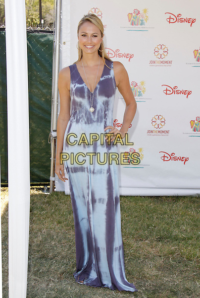 "STACY KEIBLER.The 20th annual ""A Time for Heroes"" Celebrity Carnival benefiting Elizabeth Glaser Pediatric AIDS Foundation held at Wadsworth Theater on the Veteran Administration Lawn in West Los Angeles, California, USA. .June 7th, 2009.full length purple blue long maxi tie dye dress pattern hand on hip kiebler .CAP/DVS                                                  .©Debbie VanStory/Capital Pictures."