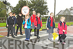 Killarney schoolkids from the Monastry and Holy Cross National schools who have to stop traffic themselves at the Library pededstrian crossing after the removal of their Lollipop man Gearoid Sugrue holds the lollipop son the front to back Eabha Stack, Emma Kelly, Aisling Stack, Ava Sheehan, Erin Moloney, Petr Lesko, and Christopher O'Brien can cross