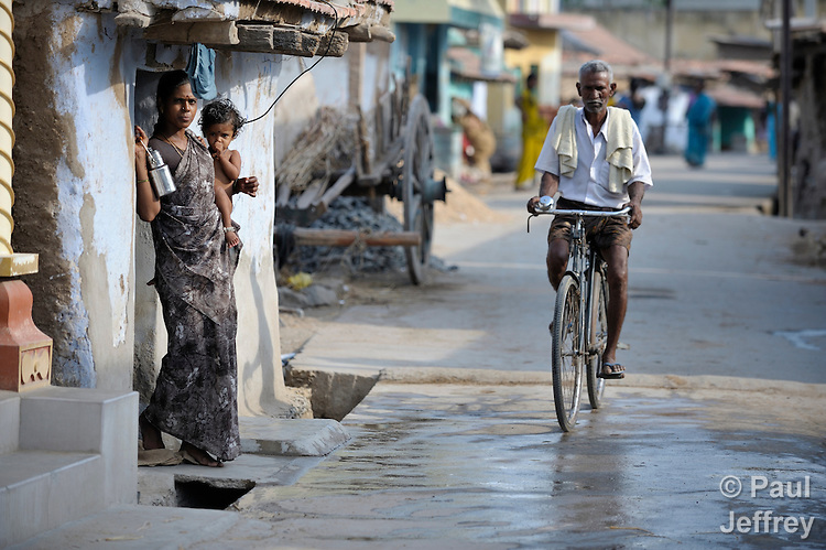 A man rides a bicycle on a street in Sathangudi, a village in the southern Indian state of Tamil Nadu.