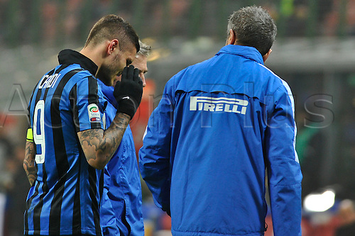 06.03.2016. Milan, Italy.  Mauro Icardi of FC Inter leaves the field with medics during the Italian Serie A League soccer match between Inter Milan and US città Palermo at San Siro Stadium in Milan, Italy.