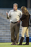 23 October 2014: FSU head coach Mark Krikorian (left) talks to TV broadcaster Jenn Hildreth (right). The University of North Carolina Tar Heels hosted the Florida State University Seminoles at Fetzer Field in Chapel Hill, NC in a 2014 NCAA Division I Women's Soccer match. The game ended in a 1-1 tie after double overtime.