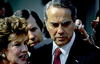 Secretary of Transportion Elizabeth Dole and her husband Senator Robert Dole Republican from Kansas talk with members of the media outside the White House after Secretary Dole had informed President Ronald Reagan that she was givng up her job to work on her husbands presidential campaign Washington DC, September 14, 1987. Credit: Mark Reinstein/MediaPunch