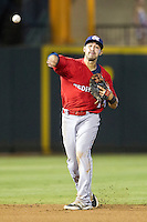 Oklahoma City RedHawks shortstop Jiovanni Mier (14) makes a throw to first base during the Pacific Coast League baseball game against the Round Rock Express on August 1, 2014 at the Dell Diamond in Round Rock, Texas. The Express defeated the RedHawks 6-5. (Andrew Woolley/Four Seam Images)