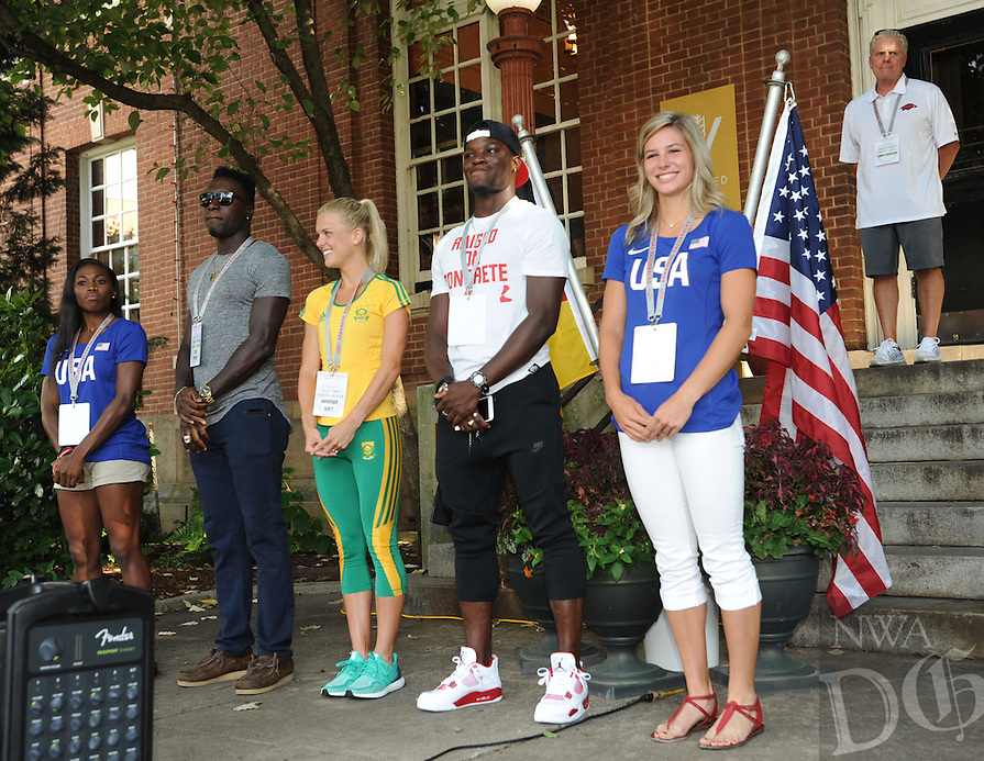 NWA Democrat-Gazette/ANDY SHUPE<br /> Olympians Chrishuna Williams (from left), Clive Pullen, Dominique Scott, Omar McLeod and Lexi Weeks smile Thursday, July 28, 2016, as they gather together during a celebration for Razorbacks athletes who will be participating in the upcoming Olympics in Rio de Janeiro on the Fayetteville square. Seven current and former Arkansas track and field athletes who will represent the United States, Jamaica and South Africa were joined by several former Olympians with Arkansas ties.