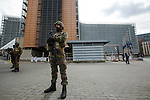 "BRUSSELS - BELGIUM - 22 March 2016 -- Bomb attacks in Brussels Maelbeek metro station - EU quarters - the military has doubled at the EU-Commission Headquarter ""Berlaymont"" where the flags are at half-mast. -- PHOTO: Juha ROININEN / EUP-IMAGES"