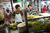 Hawker stall owners are seen preparing food in capital Georgetown of Penang in Malaysia. Photo: Sanjit Das/Panos