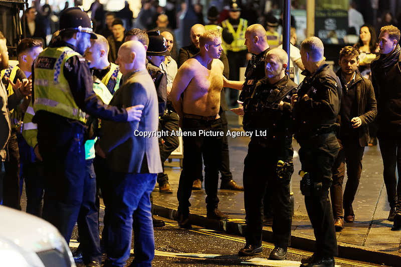 Police officers detain a man in Wind Street, Swansea, Wales  on Mad Friday, Booze Black Friday or Black Eye Friday, the last Friday night before Christmas Day, when traditionally people in the UK go out to celebrate the start of their holidays. Friday 22 December 2017