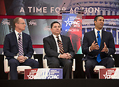 The three Republican appointees to the Federal Communications Commission (FCC) from left to right: Brendan Carr, member, Federal Communications Commission (FCC); Michael O'Rielly, member, FCC; and Ajit Pai, Chairman, FCC, speak at the Conservative Political Action Conference (CPAC) at the Gaylord National Resort and Convention Center in National Harbor, Maryland on Friday, February 23, 2018.<br /> Credit: Ron Sachs / CNP