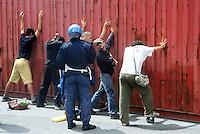 - manifestations against the international G8 summit in Genoa, July 2001, the police searches some young demonstrators....- manifestazioni contro il summit internazionale G8 a Genova nel luglio 2001, la polizia perquisisce alcuni giovani dimostranti