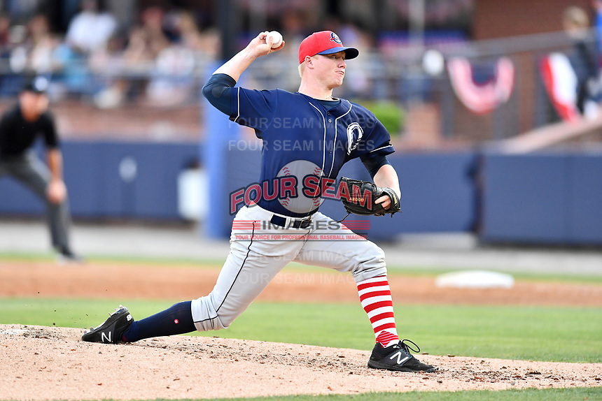 Charleston RiverDogs starting pitcher Nick Nelson (26) delivers a pitch during a game against the Asheville Tourists at McCormick Field on July 4, 2017 in Asheville, North Carolina. The Tourists defeated the RiverDogs 2-1. (Tony Farlow/Four Seam Images)