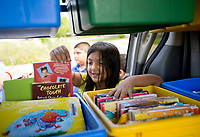 NWA Democrat-Gazette/JASON IVESTER<br /> Amy Peraza (cq), 8, selects a book Tuesday, June 13, 2017, from the Sonora Elementary Mobile Library during its stop at the playground on Commons Avenue in Springdale.