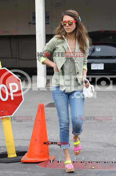 Feeling like neon today? Jessica Alba chose a colorful outfit today and wore red rimmed wayfarers, a cropped blazer jacket with green asymmetrical stripes, neon nail polish and neon colored wedges topped with a plain white Gerard Darel bag. Los Angeles, California on 12.6.2012..Credit: Correa/face to face.. /MediaPunch Inc. ***FOR USA ONLY*** NORTEPHOTO.COM<br /> NORTEPHOTO.COM