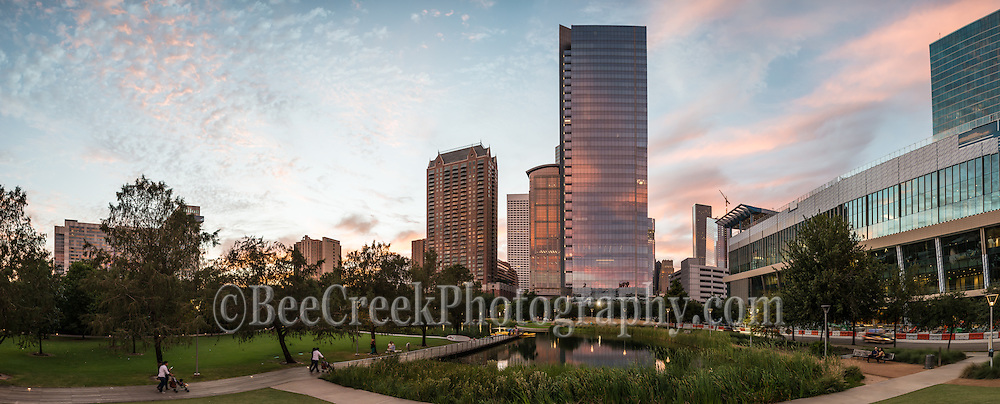 The Discovery Green sunset sky with the colors in the sky reflecting back on the high rise buildings surrounding the Discovery Green park in this panorama in downtown Houston.  The lake pick up some of the color from the skyscraper in the skyline. The cityscape of Houston as the sun set was stunning today.  Houston has some great parks and the Discovery Green park has a lot to offer, its in the heart of downtown, across from the George Brown Convention Center across the street from several hotels and many first class restaurants.  There is the kinder lake where you can rent a kayak, or cool off in the spray fountain, or listen to music or one of the many free events that take place here almost every day. Watermark will not appear on image