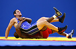 GUADALAJARA, MEXICO - OCTOBER 21:  Panaglotys Gounaridis of the USA is turned by Yunior Estrada of Cuba in the Men's Greco-Roman Semifinal Bout during Day Six of the XVI Pan American Games at the Code II Sports Complex on October 21, 2011 in Guadalajara, Mexico.  (Photo by Donald Miralle for Mexsport) *** Local Caption ***