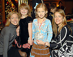 From left: Megan Martin and her daughter Courtney Pulaite,5, and Morgan Meynier,5, and her mother Dixie at the Houston Symphony League's annual Magical Musical Morning event at the Houstonian Saturday Dec. 12,2009.(Dave Rossman/For the Chronicle)