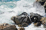 Incoming Ocean Surf Crashing into Rugged Rocks along the Coast of Maine