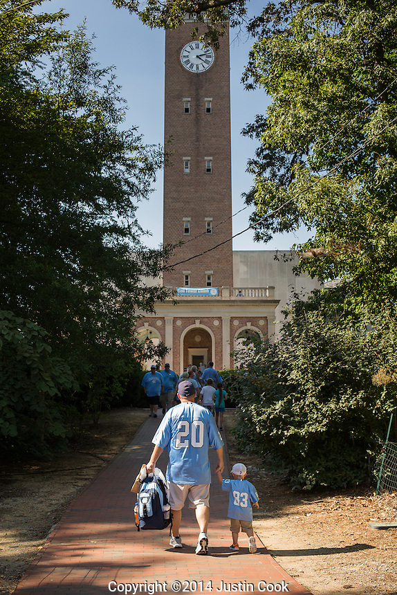Families lined up to climb the bell tower outside Kenan Stadium before The University of North Carolina Tar Heels took on the Liberty University Flames in a NCAA College Football game in Chapel Hill, N.C. on Saturday, August 30, 2014. (Justin Cook)