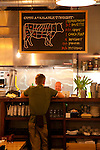 Laurelhurst Market where during the day a butcher shop offers fresh, all natural meats and at night, a full service restaurant featuring local, fresh ingredients. A chalkboard hangs above the open kitchen and features the available cuts of meat for the evening.