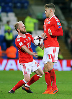 (L-R) Jonathan Williams of Wales tries to control the ball with team mate Aaron Ramsey during the FIFA World Cup Qualifier Group D match between Wales and Republic of Ireland at The Cardiff City Stadium, Wales, UK. Monday 09 October 2017